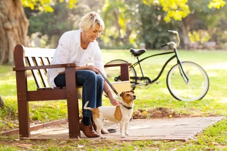 resilient woman relaxing outdoors with pet dog