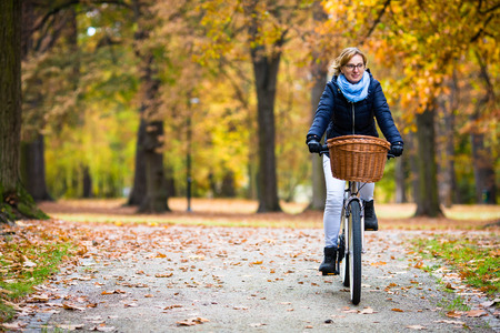 A woman exploring her community by bicycle.